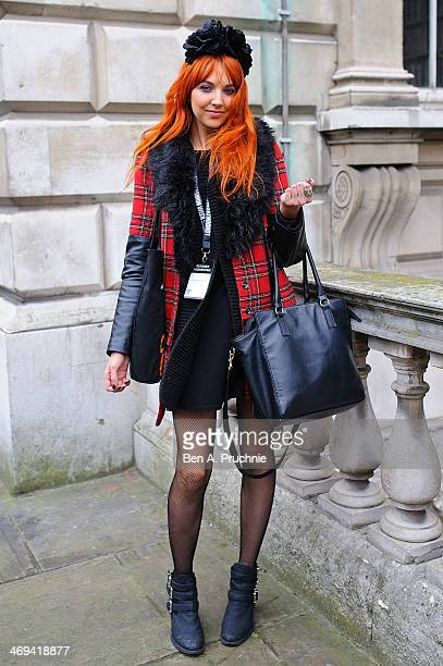 Hannah poses wearing a Primark Coat with Top Shop dress Zara bag with HM shoes and a home made head dress at Somerset House at London Fashion Week...