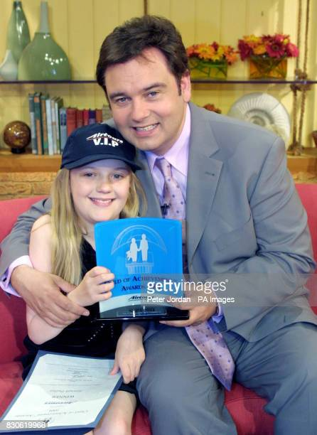 Hannah Pudsey is presented the Child of Achievement award by GMTV presenter Eamonn Holmes on the set of GMTV at the London studios * Hannah from...