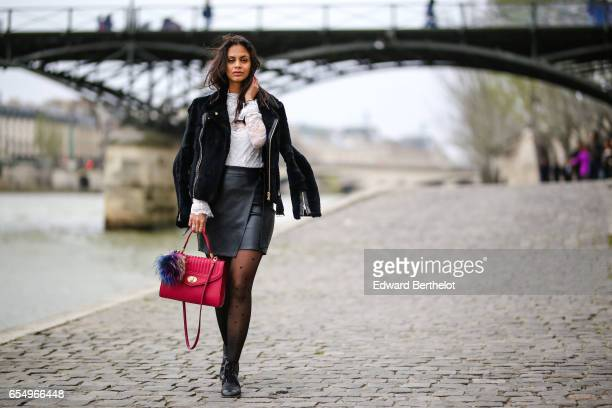 Hannah Romao fashion blogger Chanel black leather shoes Calzedonia tights a Maje white lace top a Maje coat and a Delage pink bag with a pompom on...