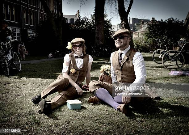 Hannah Royal and Nathan Baker are photographed in St Pancras Gardens during The Tweed Run on April 18 2015 in London England The Tweed Run is a 12...