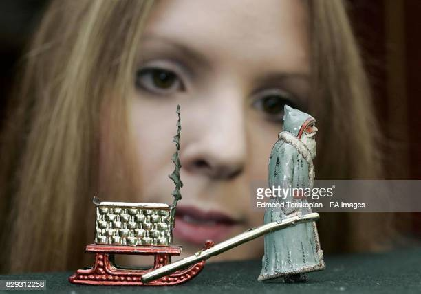 Hannah Schmidt looking at a very rare 'Meier Santa Claus Pulling Sleigh' valued at 4000 6000 from the David Pressland Collection of fine penny toys...
