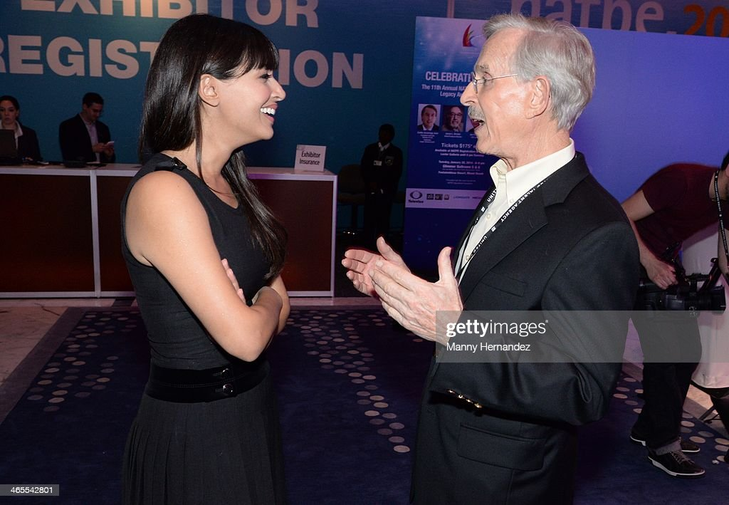 <a gi-track='captionPersonalityLinkClicked' href=/galleries/search?phrase=Hannah+Simone&family=editorial&specificpeople=3291351 ng-click='$event.stopPropagation()'>Hannah Simone</a> and Dickie Smothers are sighted at NATPE 2014 in Miami Beach at Fontainebleau Miami Beach on January 27, 2014 in Miami Beach, Florida.