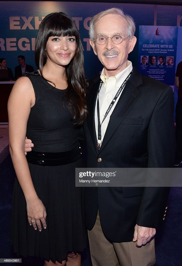 Hannah Simone and Dickie Smothers are sighted at NATPE 2014 in Miami Beach at Fontainebleau Miami Beach on January 27, 2014 in Miami Beach, Florida.