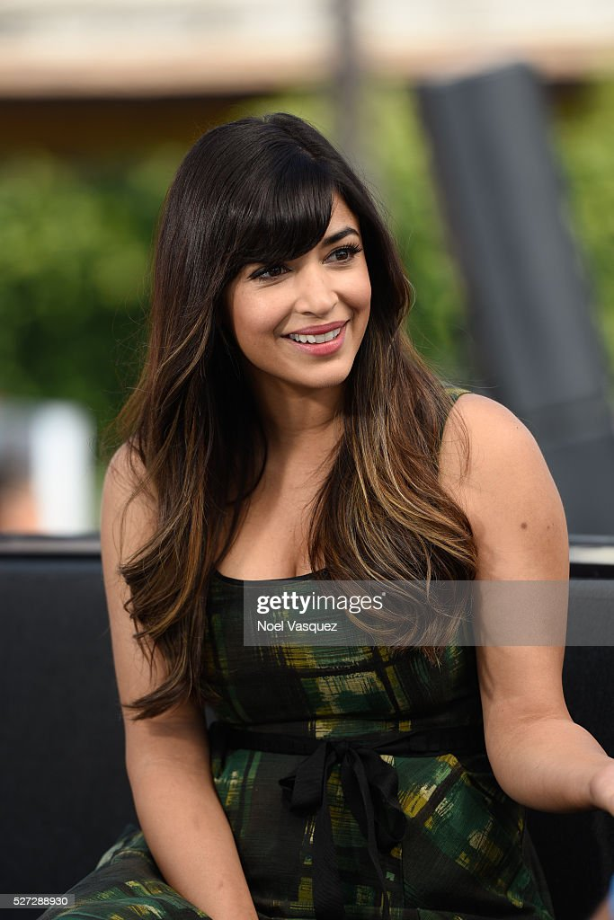 Hannah Simone visits 'Extra' at Universal Studios Hollywood on May 2, 2016 in Universal City, California.