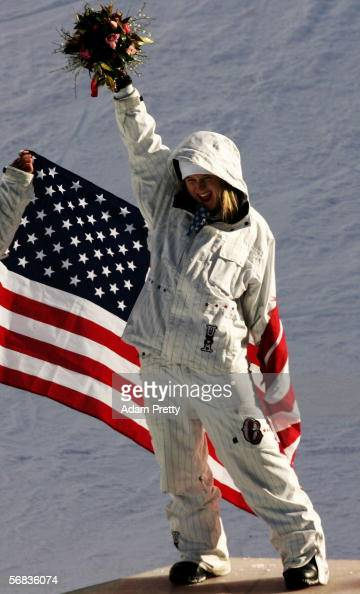 Hannah Teter of the United States celebrates winning the gold medal in the Womens Snowboard Half Pipe Final on Day 3 of the 2006 Turin Winter Olympic...