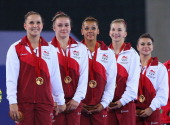 Hannah Whelan Kelly Simm Ruby Harrold Claudia Fragapane and Rebecca Downie of England receive their gold medals during the medal ceremony for the...