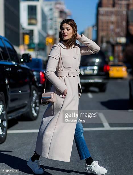 Hanneli Mustaparta is wearing a creme belted wool coat seen outside Public School during New York Fashion Week Women's Fall/Winter 2016 on February...