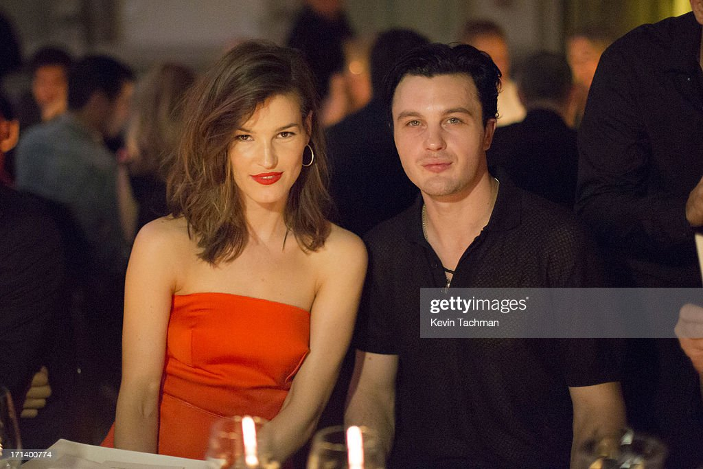 Hanneli Mustaparta, left, and actor Michael Pitt attend the dinner to celebrate Italo Zucchelli's ten years as Calvin Klein Collection's mens creative director on June 23, 2013 in Milan, Italy.