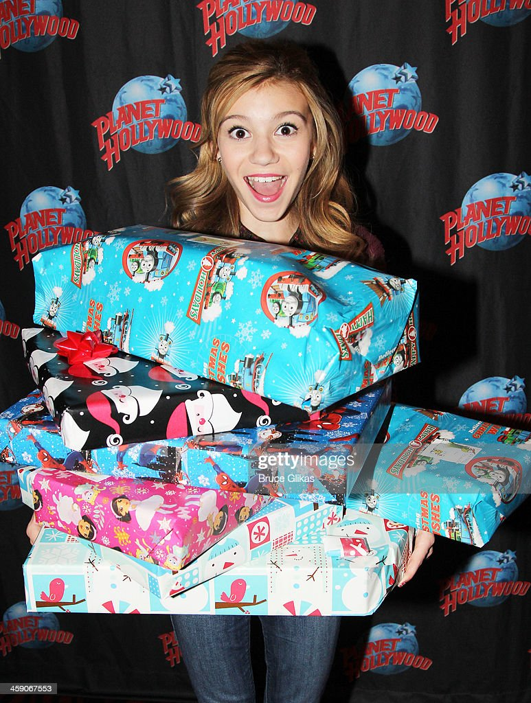 G. Hannelius of Disney's'Dog with a Blog' hosts a special holiday party for underprivileged children from WHEDco (a local outreach program in the South Bronx) at Planet Hollywood Times Square on December 22, 2013 in New York City.