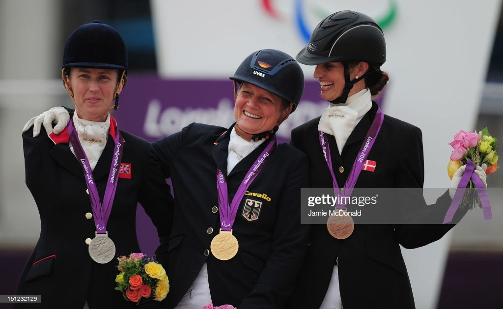Hannelore Brenner of Germany wins Gold, Deborah Criddle of Great Britain wins Silver and Annika Dalskov of Demark wins Bronze during the Equestrian Dressage Individual Freestyle Test - Grade III on day 6 of the London 2012 Paralympic Games at Greenwich Park on September 4, 2012 in London, England.