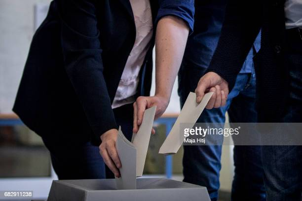 Hannelore Kraft lead candidate of the German Social Democrats casts her ballot with her son Jan and husband Udo in state elections in North...