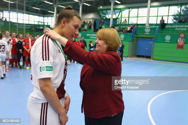 Hannelore Ratzeburg DFB vice president hands out bronze medals to the team of 1 FC Nuernberg on the podium during the B Junior Girl's German Futsal...