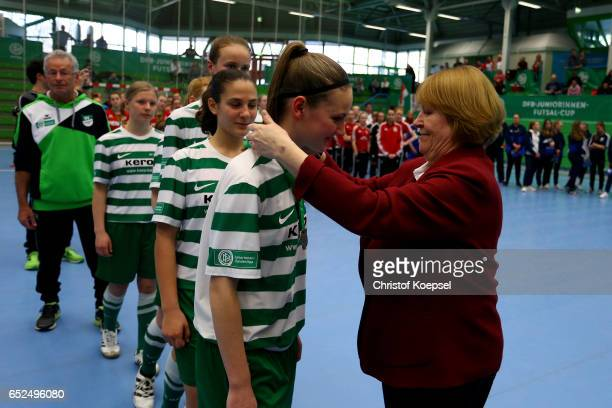 Hannelore Ratzeburg DFB vice president hands out the gold medal to the teamof SV Alberweiler on the podium of the B Junior Girl's German Futsal...