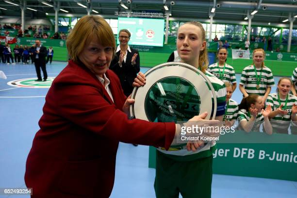 Hannelore Ratzeburg DFB vice president hands out the trophy to Luisa Daikeler of SV Alberweiler of the B Junior Girl's German Futsal Championship...