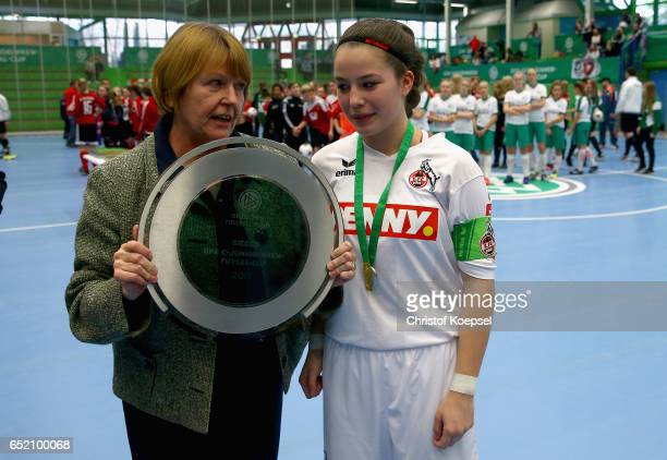 Hannelore Ratzeburg DFB vice president hands out the winning trophy to Nina Pelzer of 1 FC Koeln during the C Junior Girl's German Futsal...