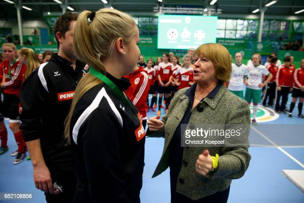 Hannelore Ratzeburg DFB vice president honours the winning team of 1 FC Koeln on the podium after the C Junior Girl's German Futsal Championship at...