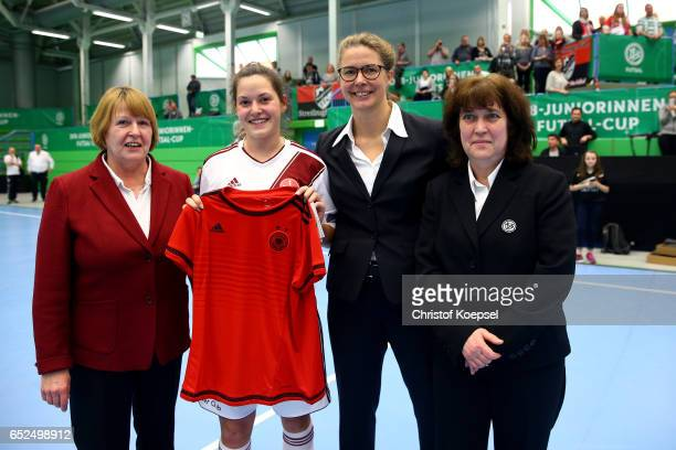 Hannelore Ratzeburg DFB vice president Sabine Nellen and Ina Hobracht DFB Women' committee hand out a jersey to top scorer Nadine Nischler of 1 FC...