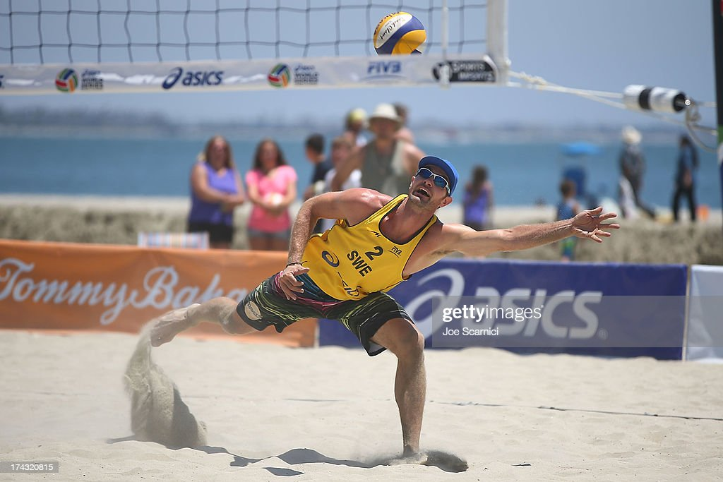 Hannes Brinkborg of Sweden dives for the ball during play at the ASICS World Series of Beach Volleyball - Day 2 on July 23, 2013 in Long Beach, California.