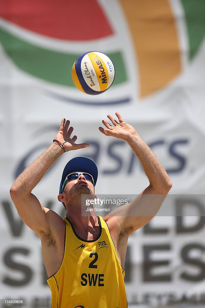 Hannes Brinkborg of Sweden sets the ball during play at the ASICS World Series of Beach Volleyball - Day 2 on July 23, 2013 in Long Beach, California.