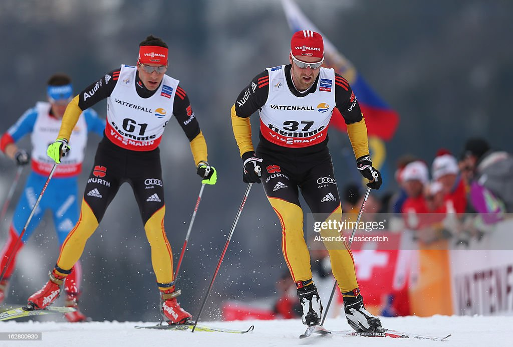 Hannes Dotzler and Axel Teichmann (r) of Germany in action during the Men's Cross Country Individual 15km at the FIS Nordic World Ski Championships on February 27, 2013 in Val di Fiemme, Italy.