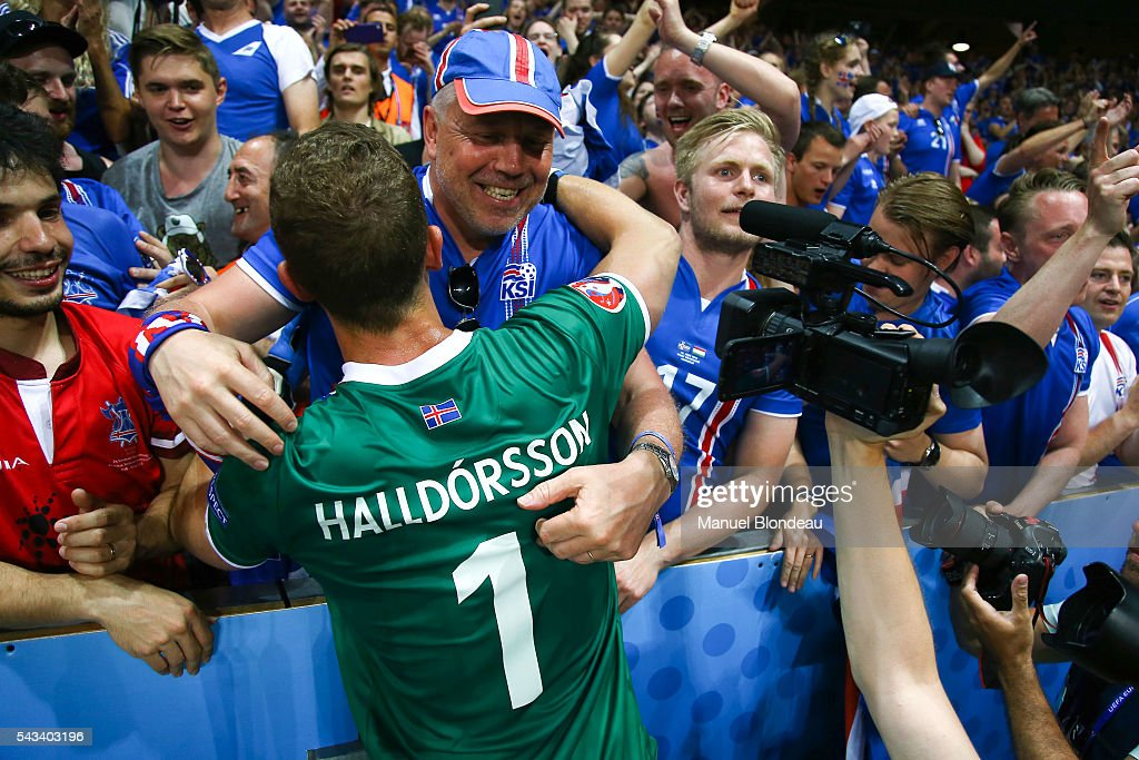 Hannes Halldorsson of Iceland celebrates with supporters during the European Championship match Round of 16 between England and Iceland at Allianz Riviera Stadium on June 27, 2016 in Nice, France.