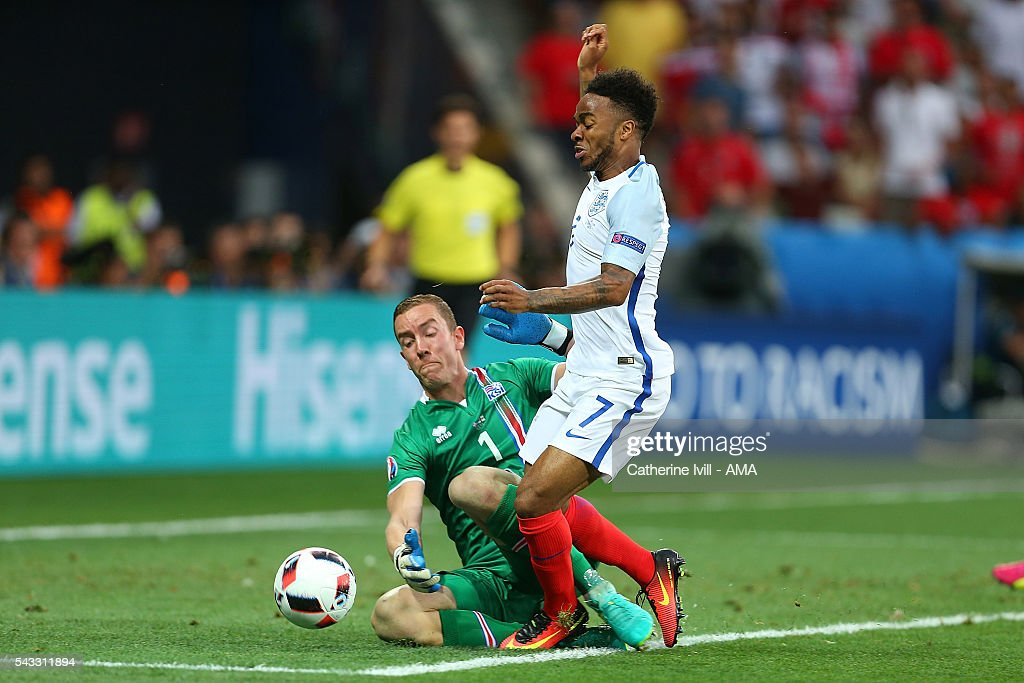 Hannes Halldorsson of Iceland fouls <a gi-track='captionPersonalityLinkClicked' href=/galleries/search?phrase=Raheem+Sterling&family=editorial&specificpeople=6489439 ng-click='$event.stopPropagation()'>Raheem Sterling</a> of England to concede a penalty during the UEFA Euro 2016 Round of 16 match between England and Iceland at Allianz Riviera Stadium on June 27, 2016 in Nice, France.