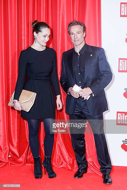 Hannes Jaenicke and guest attend the Ein Herz fuer Kinder Gala 2014 at Tempelhof Airport on December 6 2014 in Berlin Germany