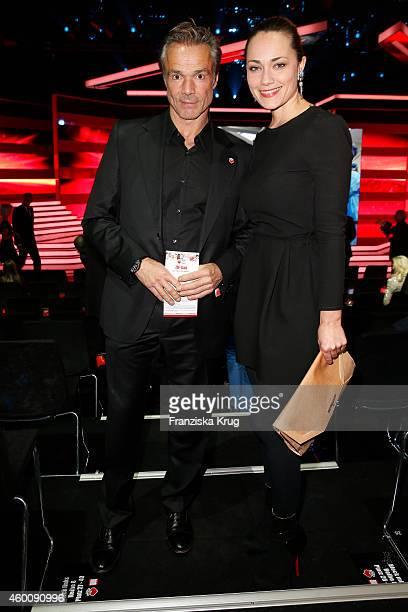 Hannes Jaenicke and Sarah Maria Besgen attend the Ein Herz Fuer Kinder Gala 2014 Red Carpet Arrivals on December 6 2014 in Berlin Germany