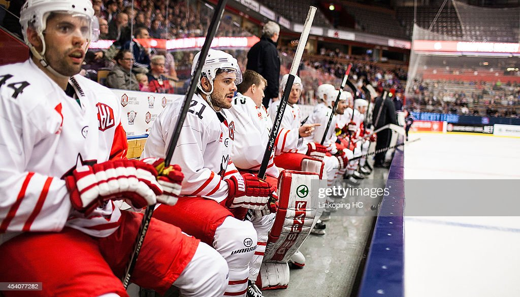 Hannes Oberdorfer #44 and Roland Hofer #21 of HC Bolzano relax on the bench during the Champions Hockey League group stage game between Linkoping HC and HC Bolzano on August 24, 2014 in Linkoping, Sweden.
