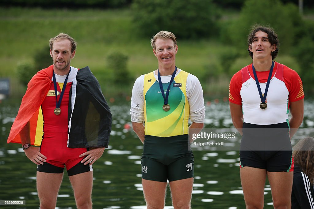 Hannes Obreno of Belgium, Rhys Grant of Australia and Bendeguz Petervari-Molnar of Hungary pose for a photo after qualifying for the 2016 Summer Olympic Games in Rio during Day 3 of the 2016 FISA European And Final Olympic Qualification Regatta at Rotsee on May 24, 2016 in Lucerne, Switzerland.