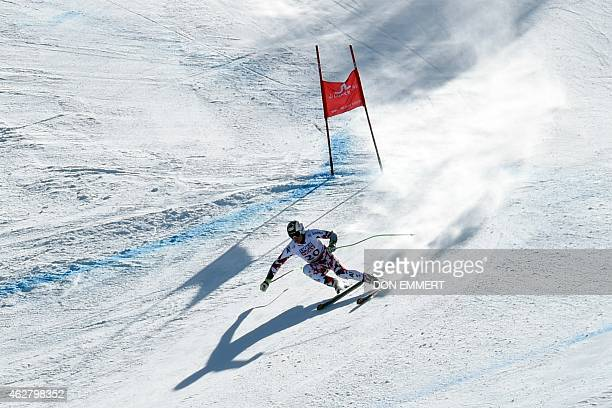 Hannes Reichelt of Austria carves past a gate during his run in the 2015 World Alpine Ski Championships men's Super G February 5 2015 in Beaver Creek...