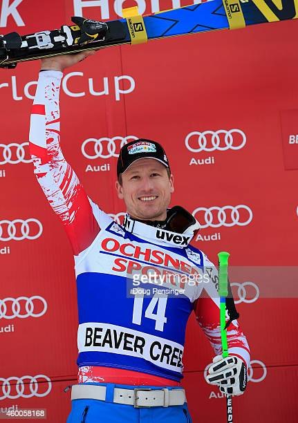 Hannes Reichelt of Austria celebrates on the podium after winning the Audi FIS World Cup Men's Super G Race on the Birds of Prey course on December 6...