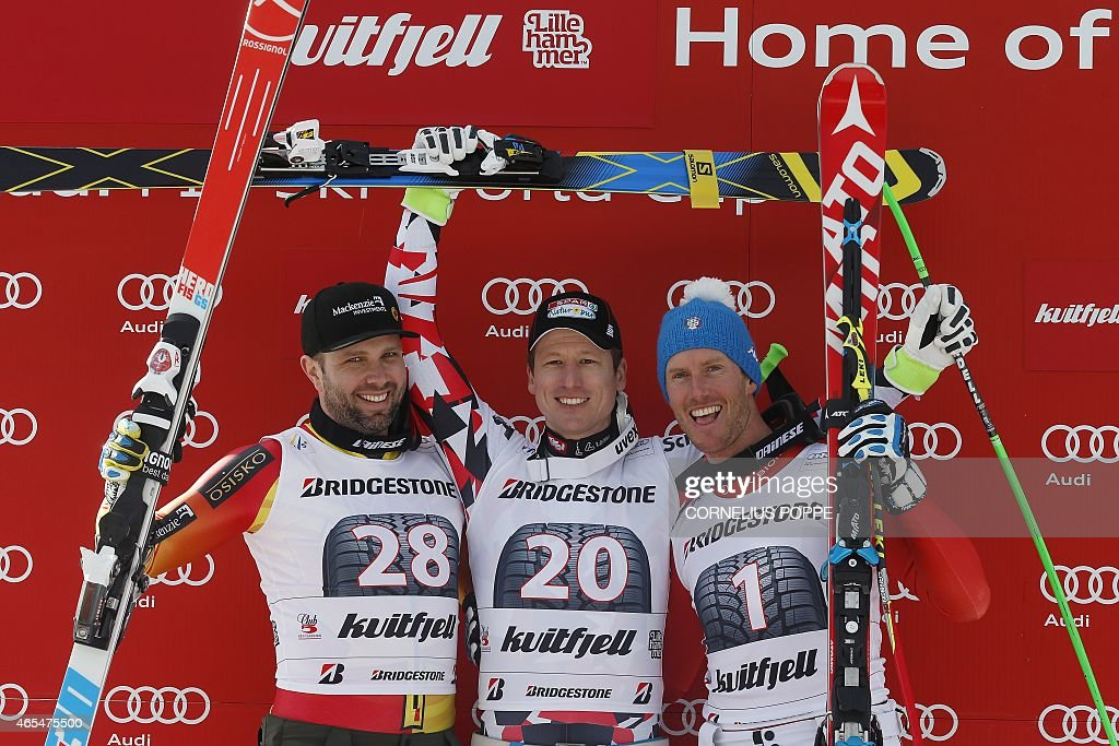 Hannes Reichelt of Austria jubilates on the podium after winning the men's Alpine Skiing World Cup downhill race with second placed Manuel...