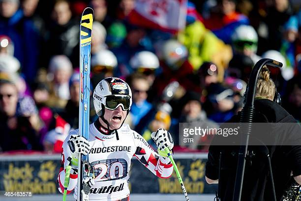 Hannes Reichelt of Austria reacts reacts in the finish area after his run during the Men's Downhill race at the FIS Alpine Skiing World Cup in...