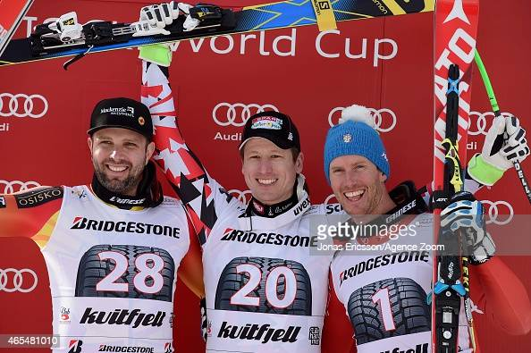 Hannes Reichelt of Austria takes 1st place Manuel OsborneParadis of Canada takes 2nd place Werner Heel of Italy takes 3rd place during the Audi FIS...