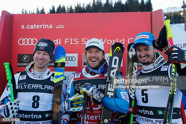 Hannes Reichelt of Austria takes 2nd place Kjetil Jansrud of Norway takes 1st place Dominik Paris of Italy takes 3rd place during the Audi FIS Alpine...