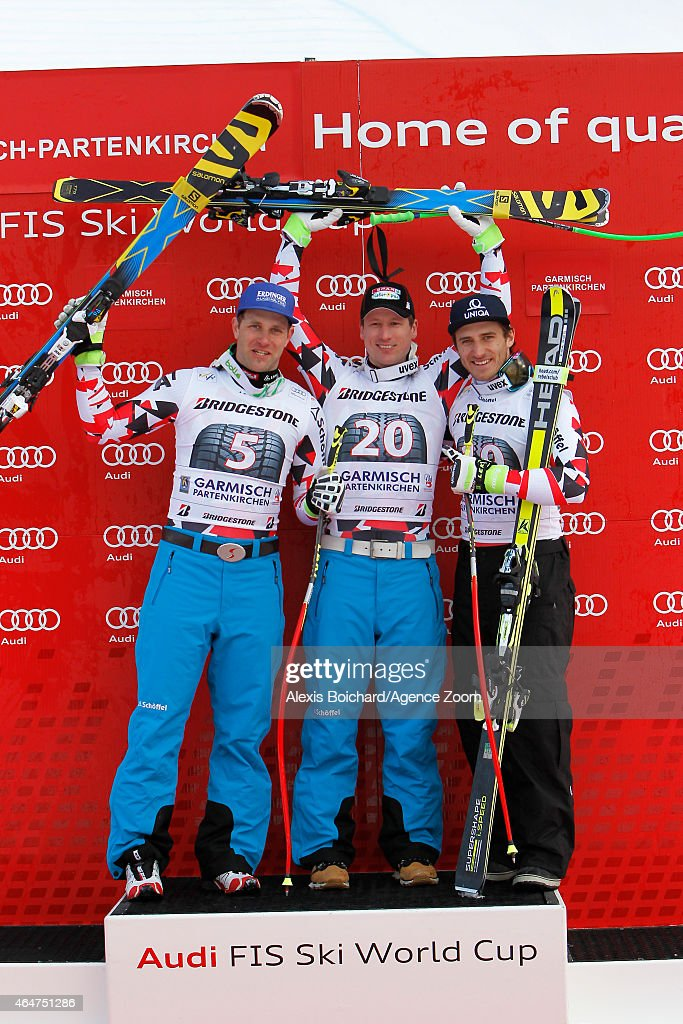 Hannes Reichelt of Austria takes the 1st placeRomed Baumann of Austria take the 2nd place Matthias Mayer of Austria takers the 3rd place during the...