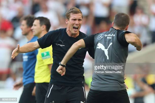 Hannes Wolf head coach of Stuttgart celebrates after the Bundesliga match between VfB Stuttgart and 1 FSV Mainz 05 at MercedesBenz Arena on August 26...