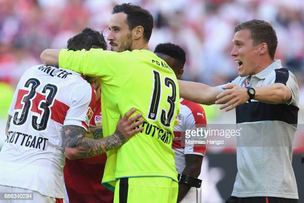 Hannes Wolf head coach of Stuttgart celebrates winning the 2 Second Bundesliga Championship title with his players Mitchell Langerak and Daniel...