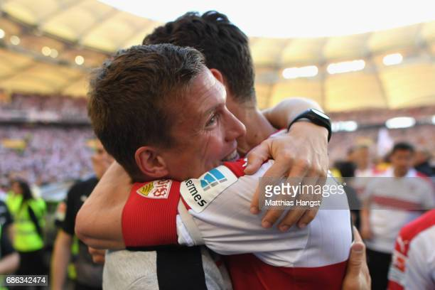 Hannes Wolf head coach of Stuttgart celebrates winning the 2 Second Bundesliga Championship title with his player Christian Gentner after the 2...