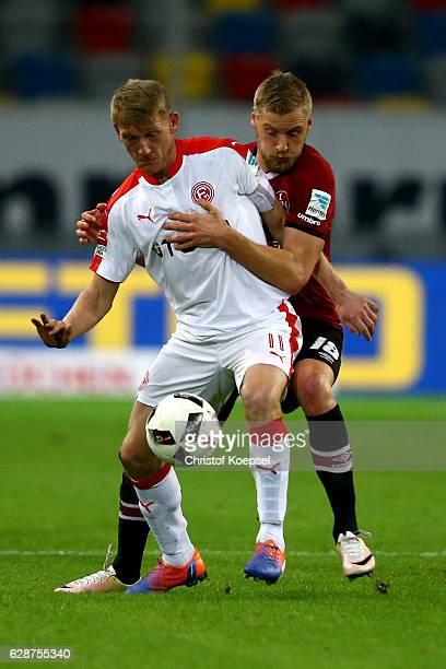 Hannmo Behrens of Nuernberg challenges Axel Bellinghausen of Duesseldorf during the Second Bundesliga match between Fortuna Duesseldorf and 1 FC...