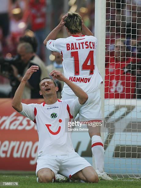 Hanno Balitsch and Dariusz Zuraw of Hanover react during the Bundesliga match between VfB Stuttgart and Hanover 96 at the GottliebDaimler stadium on...