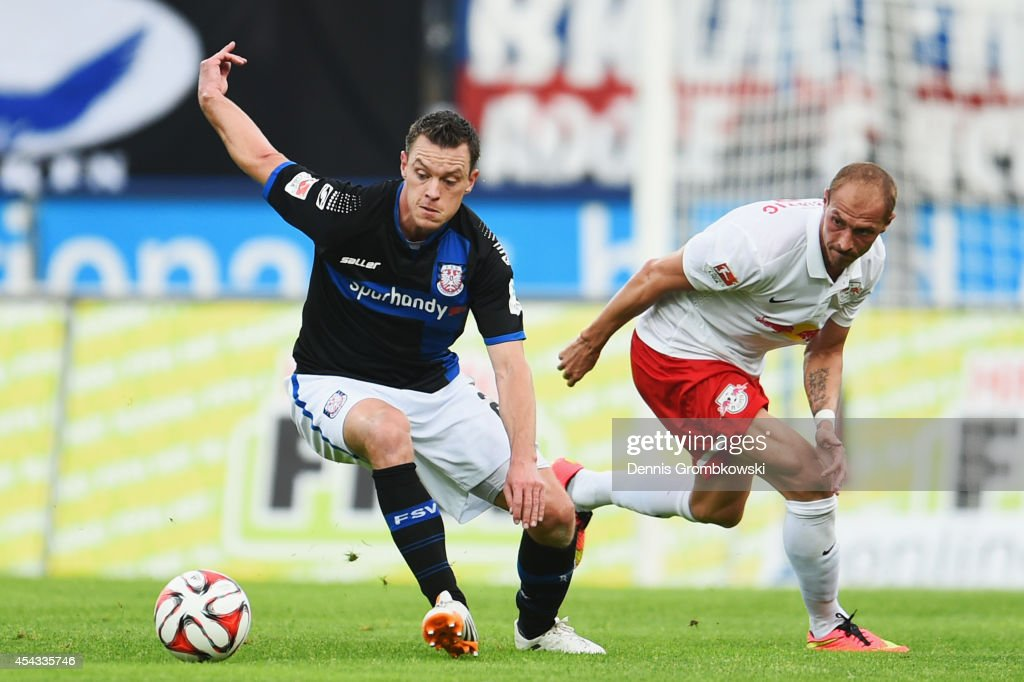 <a gi-track='captionPersonalityLinkClicked' href=/galleries/search?phrase=Hanno+Balitsch&family=editorial&specificpeople=635099 ng-click='$event.stopPropagation()'>Hanno Balitsch</a> of FSV Frankfurt is challenged by Matthias Morys of RB Leipzig during the Second Bundesliga match between FSV Frankfurt and RB Leipzig at Volksbank Stadion on August 29, 2014 in Frankfurt am Main, Germany.