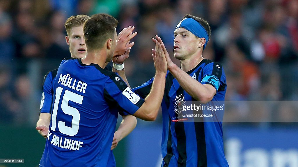 <a gi-track='captionPersonalityLinkClicked' href=/galleries/search?phrase=Hanno+Balitsch&family=editorial&specificpeople=635099 ng-click='$event.stopPropagation()'>Hanno Balitsch</a> of Mannheim (R) celebrates with Marco Mueller of Mannheim (L) after the Third League play-off first leg match between SF Lotte and Waldhof Mannheim at Sportpark am Lotter Kreuz on May 25, 2016 in Lotte, Germany. The match between Lotte and Mannheim ended 0-0.