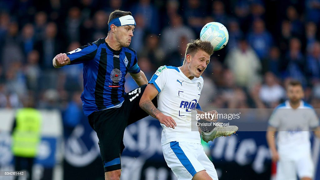 <a gi-track='captionPersonalityLinkClicked' href=/galleries/search?phrase=Hanno+Balitsch&family=editorial&specificpeople=635099 ng-click='$event.stopPropagation()'>Hanno Balitsch</a> of Mannheim fouls Nico Neidhart of Sportfreunde Lotte during the Third League play-off first leg match between SF Lotte and Waldhof Mannheim at Sportpark am Lotter Kreuz on May 25, 2016 in Lotte, Germany.