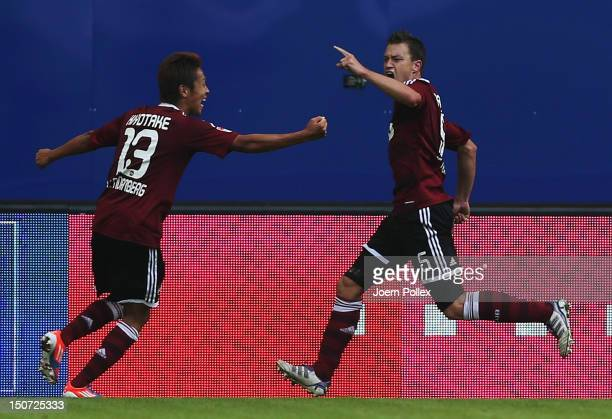 Hanno Balitsch of Nuernberg celebrates with his team mate Hiroshi Kiyotake after scoring his team's first goal during the Bundesliga match between...