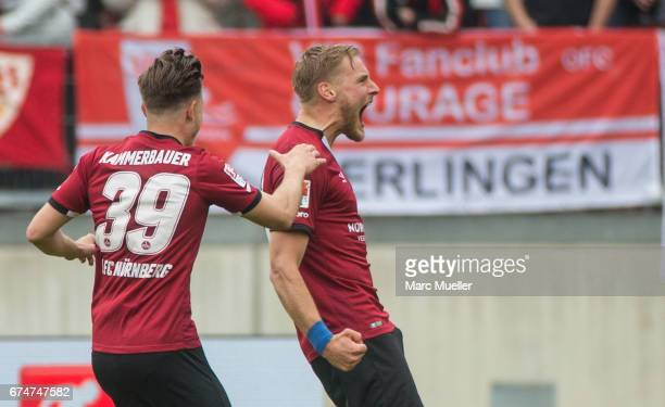 Hanno Behrens and Patrick Kammerbauer of Nuernberg celebrate the first goal against Stuttgart during the Second Bundesliga match between 1 FC...