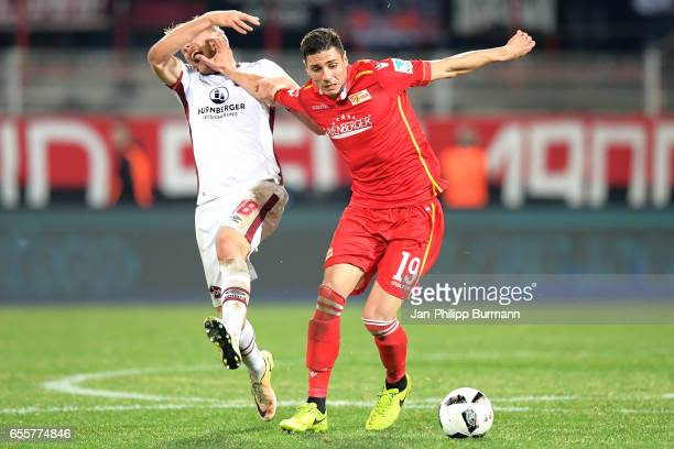 Hanno Behrens of 1 FC Nuernberg and Damir Kreilach of 1 FC Union Berlin during the game between 1 FC Union Berlin and 1 FC Nuernberg on March 20 2017...