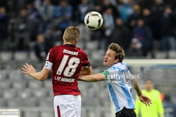 Hanno Behrens of 1 FC Nuernberg and Kai Buelow of TSV 1860 Muenchen battle for the ball during the Second Bundesliga match between TSV 1860 Muenchen...