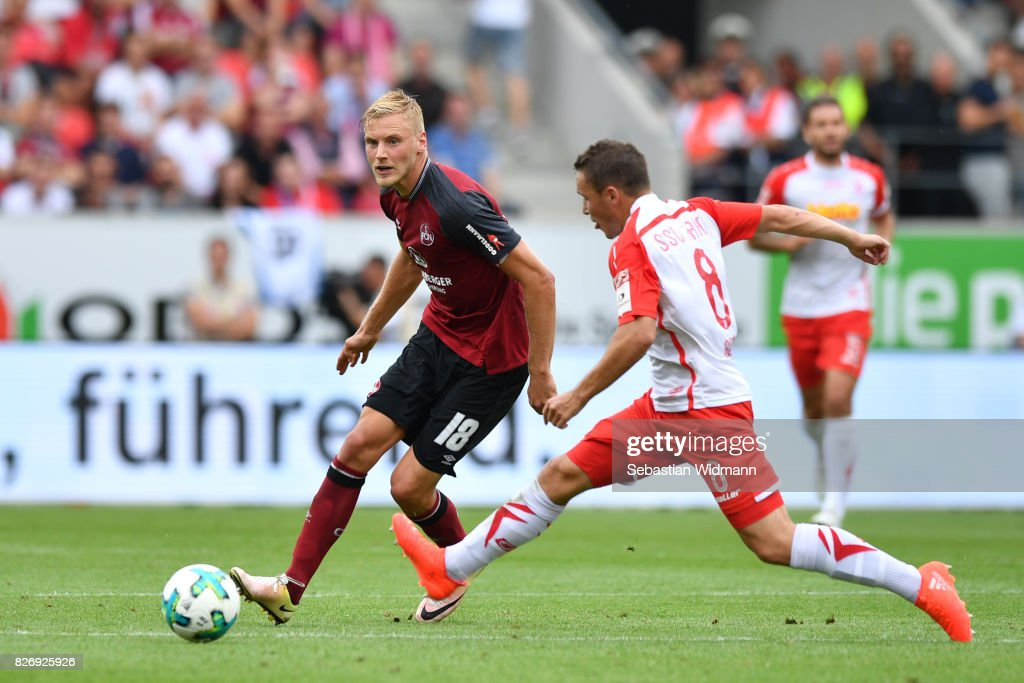 Hanno Behrens of 1. FC Nuernberg plays the ball during the Second Bundesliga match between SSV Jahn Regensburg and 1. FC Nuernberg at Continental Arena on August 6, 2017 in Regensburg, Germany.